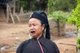 Burma / Myanmar: Enn (also Ann or Eng) woman with characteristic black teeth, Wan Mai village near Kyaing Tong (Kengtung), Shan State