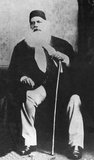 Born into Mughal nobility, Sir Syed earned a reputation as a distinguished scholar while working as a jurist for the British East India Company's rule in India. During the Indian Rebellion of 1857, he remained loyal to the British Empire and was noted for his actions in saving European lives.<br/><br/>  After the rebellion, he penned the booklet 'The Causes of the Indian Mutiny' – a daring critique, at the time, of British policies that he blamed for causing the revolt. Believing that the future of Muslims was threatened by the rigidity of their orthodox outlook, Sir Syed began promoting Western–style scientific education by founding modern schools and journals and organising Muslim entrepreneurs.<br/><br/>  Towards this goal, Sir Syed founded the famous Aligarh Muslim University (AMU, earlier known as Anglo-Muhammadan Oriental College) in 1875 with the aim of promoting social, scientific, and economic development of Indian Muslims.