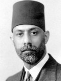 Choudhry Rahmat Ali (Urdu: چودھری رحمت علی) (16 November 1895 – 3 February 1951) was a Pakistani Muslim nationalist who was one of the earliest proponents of the creation of the state of Pakistan.<br/><br/>  He is credited with creating the name 'Pakistan' for a separate Muslim homeland in South Asia and is generally known as the founder of the movement for its creation.