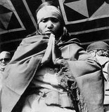 Phoolan Devi (10 August 1963 – 25 July 2001), popularly known as 'Bandit Queen', was an Indian bandit and later a politician. Born to a low caste family in rural Uttar Pradesh, Devi's early years were characterised by numerous incidents of sexual abuse, followed by a criminal career she later became known for.<br/><br/>  At the age of 18 Devi was gang-raped by high-caste bandits after the gang she was part of was ambushed by rivals. As a result of this incident she became a gang leader in her own right and sought revenge. In 1981 Devi and her gang returned to the village where she had been raped and 22 Thakur caste villagers, including two of her rapists, were rounded up and executed.<br/><br/>  The press portrayed the Behmai massacre as an act of righteous lower-caste rebellion and Devi herself as an oppressed feminist Robin Hood. Indian police authorities argue that there is no recorded instance of Devi helping those in need.<br/><br/>  Devi and surviving gang members evaded capture for 2 years before surrendering in 1983. She was charged for 48 crimes, including murder, plunder, arson and kidnapping for ransom. After 11 years pending trial, the state government withdrew all charges against her and she was released in 1994. She then ran for election as a candidate of the Samajwadi Party and was elected to parliament.<br/><br/>  In 2001 Devi was assassinated in New Delhi by a trio of upper-caste men.