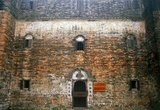 Yinglong Lou was built in the reign of the Jiajing Emperor (1522-1566) and is the oldest extant <i>diaolou</i> in the Kaiping region.<br/><br/>  The Kaiping Diaolou (watchtowers) are fortified multi-storey towers. The first towers were built during the early Qing Dynasty (1614 - 1912), reaching a peak in the 1920s and 1930s, when there were more than three thousand of these structures. Today, approximately 1,833 diaolou remain standing in Kaiping, and approximately 500 in Taishan. Although the diaolou served mainly as protection against forays by bandits, a few of them also served as living quarters.<br/><br/>  Kaiping has traditionally been a region of major emigration abroad, and a melting pot of ideas and trends brought back by overseas Chinese. As a result, many diaolou incorporate architectural features from China and from the West.