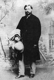 Moses Wilhelm Shapira was born in 1830 to Polish-Jewish parents in Kamenets-Podolski, which at the time was part of Russian-annexed Poland (in modern-day Ukraine). Shapira's father emigrated to Ottoman Palestine and in 1856, at the age of 25, Moses Shapira followed.<br/><br/>  On the way, while in Bucharest, Moses Shapira converted to Christianity and applied for German citizenship. Once in Jerusalem, he joined the community of Anglican missionaries and converts and in 1861 opened a store in the Street of the Christians, today's Christian Quarter Road. He sold the usual religious souvenirs enjoyed by pilgrims, as well as ancient pots he acquired from Arab farmers.<br/><br/>  In 1883 Shapira presented what is now known as the Shapira Strips, a supposedly ancient scroll written on leather strips which he claimed had been found near the Dead Sea. The Hebrew text hinted at a different version of Deuteronomy, including a surprising eleventh commandment. Shapira sought to sell them to the British Museum for a million pounds, and allowed them to exhibit two of the 15 strips. The exhibition was attended by thousands.<br/><br/>  After close examination, French scholar Clermont-Ganneau declared them to be forgeries. Soon afterward British biblical scholar Christian David Ginsburg came to the same conclusion. Later Clermont-Ganneau showed that the leather of the Deuteronomy scroll was quite possibly cut from the margin of a genuine Yemenite scroll that Shapira had previously sold to the Museum.<br/><br/>  Shapira fled London in despair, his name ruined and all of his hopes crashed. Six months later, on March 9, 1884 he shot himself in Hotel Bloemendaal in Rotterdam.