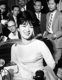 Tran Le Xuan (born April 15, 1924 in Hanoi, Vietnam), popularly known as Madame Nhu but more properly Madame Ngo Dinh Nhu, was considered the First Lady of South Vietnam from 1955 to 1963. She was the wife of Ngo Dinh Nhu, brother and chief adviser to President Ngo Dinh Diem.<br/><br/>  As Diem was a lifelong bachelor, and because the Nhus lived in the Independence Palace, she was considered to be the First Lady. Diem often appointed relatives to high positions, so her father became the ambassador to the United States while her mother, a former beauty queen, was South Vietnam's observer at the United Nations. Two of her uncles were cabinet ministers.<br/><br/>  Madame Nhu was chauffeured in a black Mercedes and wore a small diamond crucifix. She also wore form-fitting apparel so tight that one French correspondent suggestively described her as, 'molded into her ... dress like a dagger in its sheath'. On formal occasions, she wore red satin pantaloons with three vertical pleats, which was the mark of the highest-ranking women of the imperial court in ancient Annam.<br/><br/>  After the overthrow of the Diem government in 1963, Madame Nhu went into exile in France and died at Rome, Italy, in 1911.