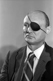 Moshe Dayan (20 May 1915 – 16 October 1981) was an Israeli military leader and politician. He was the second child born on the first kibbutz, but he moved with his family in 1921, and he grew up on a moshav (Israeli village or settlement).<br/><br/>  As commander of the Jerusalem front in Israel's War of Independence, Chief of staff of the Israel Defense Forces (1953–58) during the 1956 Suez Crisis, but mainly as Defense Minister during the Six-Day War, he became a fighting symbol of the new state of Israel.<br/><br/>  After being blamed for the army's lack of preparation before the outbreak of the 1973 Yom Kippur War, and for his failure of nerve during the war, he left the military and joined politics. As Foreign Minister Dayan played an important part in negotiating the peace treaty between Egypt and Israel.
