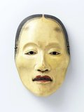 This mask for Japanese Noh theatre is worn by the actor who plays the character Yase Onna, or 'Emaciated woman'.<br/><br/>  She is the ghost of a woman who suffered a tragic love affair during her life and whose soul is tormented by the loss of her lover.