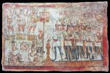 Fresco from the Temple of the Palmyran Gods in Dura Europos (c. 230 CE): An officer named Julius Terentius leads the soldiers of the 20th Palmyrenes, a cohort of mounted archers stationed on the Euphrates, in a ritual of bloodless sacrifice. He burns incense in honour of the three cult statues of gods dressed in military costume (Yarhibol, Aglibol, and Arsu), ranged on their pedestals on the upper left side of the fresco.<br/><br/>  Beside Terentius is the standard bearer of the cohort with the troop colours and, next to him, a seated goddess who wears the mural (city) crown: an inscription identifies her as the goddess of Good Fortune of Palmyra.