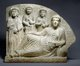 Syria: A funerary tablet or gravestone depicting a banquet. Limestone, Palmyra, 2nd-3rd century CE