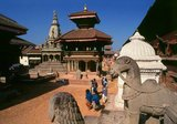 That the Durbar Square of Bhaktapur appears so much less cluttered than its counterparts in Kathmandu and Patan is simply due to the earthquake of 1934. The earthquake devastated a large number of buildings in the square and they were never reconstructed.<br/><br/>  A minor earthquake in 1988 did further damage. According to the Nepalese chronicles, Bhupatindra Malla had laid out 99 courtyards within the palace compound; in 1742, only 12 remained, and today there are but six.<br/><br/>  Durbar Square is now a relatively large open space, surrounded by buildings on its fringes but clear of any constructions in the centre. On the west side, the square is accessed through Durbar Square Gate, built by Bhupatindra Malla (1696-1722) as a main entry point to the area. He also erected the figures of monkey god Hanuman and Narasinha, the half-man, half-lion deity, along the lines of the Hanuman and Narasinha figures near the palace gate in Kathmandu.
