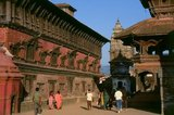 The southeastern part of Bhaktapur's Royal Palace compound is taken up by the Palace of Fifty-Five Windows, which was the actual residence of the Bhaktapur kings. The three-storied building boasts some masterly carved doors and windows on its lower floors, and on the third floor there are 55 arcaded windows. In its original form, the upper floor projected out from the building, but after the 1934 earthquake it was reconstructed in the present style.<br/><br/>  Inside the compound there is a golden water conduit, laid out in 1688, which brought in water from a source 11 kilometres away. The water was used for the daily ritual bathing of the image of goddess Taleju. Also fed by a subterranean water conduit was the Nag Pokhri, or 'Pond of the Nagas', located at the northeastern corner of the temple complex and constructed during the reign of Jagatprakasha Malla (1743-1772).