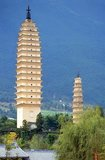The Three Pagodas (the symbols of Dali) are an ensemble of three independent pagodas just north of the town of Dali dating from the time of the Nanzhao kingdom and the Kingdom of Dali.<br/><br/>  Dali is the ancient capital of both the Bai kingdom Nanzhao, which flourished in the area during the 8th and 9th centuries, and the Kingdom of Dali, which reigned from 937-1253. Situated in a once significantly Muslim part of South China, Dali was also the center of the Panthay Rebellion against the reigning imperial Qing Dynasty from 1856-1863. The old city was built during Ming Dynasty emperor Hongwu's reign (1368–1398).