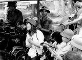 Jane Fonda visited Hanoi in July 1972. Among other statements, she repeated the North Vietnamese claim that the United States had been deliberately targeting the dike system along the Red River. In fact the dike system suffered bomb damage, but was not strategically targeted.<br/><br/>  In North Vietnam, Fonda was photographed seated on an anti-aircraft battery. In her 2005 autobiography, she writes that she was manipulated into sitting on the battery, and was immediately horrified at the implications of the pictures. After the release of the pictures of Fonda seated behind the anti-aircraft gun, she was dubbed 'Hanoi Jane' by opponents of the anti-war movement in the United States.