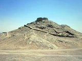 A Tower of Silence or Dakhma is a circular, raised structure used by Zoroastrians for exposure of the dead. There is no standard technical name for such a construction. The common <i>dakhma</i> or <i>dokhma</i> (from Middle Persian <i>dakhmag</i>) originally denoted any place for the dead. Similarly, in the medieval texts of Zoroastrian tradition, the word astodan appears, but today denotes an ossuary.<br/><br/>  In the Iranian provinces of Yazd and Kerman, the technical term is <i>deme</i> or <i>dema</i>. In India, the term <i>doongerwadi</i> came into use after a tower was constructed on a hill of that name. The word <i>dagdah</i> appears in the texts of both India and Iran but, in 20th century India, signified the lowest grade of temple fire (cf. Fire temple). The term 'Tower of Silence' is a neologism attributed to one Robert Murphy, who, in 1832, was a translator of the British colonial government in India.