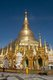 The golden stupa of the Shwedagon Pagoda rises almost 100 m (330ft) above its setting on Singuttara Hill and is plated with 8,688 solid-gold slabs. This central stupa is surrounded by more than 100 other buildings, including smaller stupas and pavilions.<br/><br/>  The pagoda was already well established when Bagan dominated Burma in the 11th century. Queen Shinsawbu, who ruled in the 15th century, is believed to have given the pagoda its present shape. She also built the terraces and walls around the stupa.<br/><br/>  The giant stupa has a circumference at platform level of 433 m (1,420ft), with its octagonal base ringed by 64 smaller stupas.