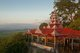 Burma / Myanmar: The setting sun lights a pavilion next to the Sutaungpyei Pagoda at the summit of Mandalay Hill, Mandalay