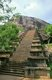 The ancient rock fortress of Yapahuwa is similar to, but smaller than, Sigiriya. Dating from the 13th century, it was the capital and main stronghold of King Bhuvanekabahu I (1272 - 1284), who was resisting invasions from south India. Today a steep ornamental stairway leads up to a platform that once supported a temple which is thought to have served as a temporary repository for the holy tooth relic, now at the Temple of the Tooth in Kandy.<br/><br/>  Yapahuwa was called Shubha-Giri in the Srilankan chronicles, lit. 'The Auspicious Mountain'.