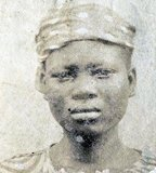 This photograph of a 'Liberated African' slave was taken after they were freed from slaving ships by the British Navy. From 1861 to 1874, more than 2500 'Liberated Africans' were shipped to Port Victoria, Seychelles.<br/><br/>  While the Slave Trade continued across eastern and southern Africa and the Indian Ocean, the 'liberated' were taken to a depot, classified by the District Magistrate, photographed, renamed, and assigned as 'apprentices' to the French-owned plantations, where they were indentured for five years.