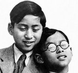 Ananda Mahidol (20 September 1925–9 June 1946) was the eighth monarch of Thailand under the House of Chakri. He was recognized as king by the National Assembly in March 1935. He was a nine-year-old boy living in Switzerland at this time. He returned to Thailand in December 1945.<br/><br/>  On 9 June 1946, the King was found dead in his bedroom in the Boromphiman Throne Hall, (a modern residential palace located within the Grand Palace), only four days before he was scheduled to return to Switzerland to finish his doctoral degree in Law at the University of Lausanne. His brother Bhumibol Adulyadej succeeded him. Ananda Mahidol was never crowned as king, but his brother posthumously gave him the full royal title of the ninefold umbrella.<br/><br/>  Bhumibol Adulyadej (Phumiphon Adunyadet; born 5 December 1927) is the current King of Thailand.  Having reigned since 9 June 1946, he is the world's longest-serving current head of state and the longest-reigning monarch in Thai history.