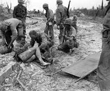 The Battle of Peleliu was fought between the United States and the Empire of Japan in the Pacific Theater of World War II, from September to November 1944 on the island of Peleliu (in present-day Palau). U.S. Marines of the First Marine Division, and later soldiers of the U.S. Army's 81st Infantry Division, fought to capture an airstrip on the small coral island.<br/><br/>  This battle was part of a larger offensive campaign known as Operation Forager, which ran from June to November 1944 in the Pacific Theater of Operations.
