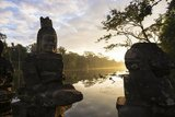 Asuras are usually seen in opposition to Devas (benevolent deities or angels).<br/><br/>  Angkor Thom, meaning 'The Great City', is located 1.5km (one mile) north of Angkor Wat. It was built in the late 12th century by King Jayavarman VII, and covers an area of 9 km², within which are located several monuments from earlier eras as well as those established by Jayavarman and his successors. It is believed to have sustained a population of 80,000-150,000 people. At the centre of the city is Jayavarman's state temple, the Bayon, with the other major sites clustered around the Victory Square immediately to the north.<br/><br/>  Angkor Thom was established as the capital of Jayavarman VII's empire, and was the centre of his massive building programme. One inscription found in the city refers to Jayavarman as the groom and the city as his bride.<br/><br/>  Angkor Thom seems not to be the first Khmer capital on the site, however, as Yasodharapura, dating from three centuries earlier, was centred slightly further northwest.<br/><br/>  The last temple known to have been constructed in Angkor Thom was Mangalartha, which was dedicated in 1295. In the following centuries Angkor Thom remained the capital of a kingdom in decline until it was abandoned some time prior to 1609.