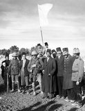 The Ottoman Mayor of Jerusalem, Hussein Effendi el Husseini (al-Husseini), meeting with Sergeants Sedgwick and Hurcomb of the 2/19th Battalion, London Regiment, under the white flag of surrender, at 8 am, 9 December, 1917.