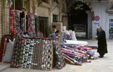 Aleppo's Great Bazaar (in Arabic, <i>suq</i> or <i>souq</i>) as we know it today was rebuilt first by the Egyptian Mamelukes who drove out the Mongols, and then, after 1516, by the Turks who incorporated Aleppo into the Ottoman Empire.<br/><br/>  During the Syrian Civil War, which started in 2011, Aleppo's historic <i>suqs</i> suffered serious damage.<br/><br/>  Aleppo, the second city of Syria and quite possibly the longest continually inhabited settlement in the world, is of venerable age. So old, indeed, that its Arabic name, Halab, is first mentioned in Semitic texts of the third millennium BCE. Situated in the north-west of the country, just a few kilometres from the Turkish frontier, Aleppo is located at the confluence of several great trade routes and, as a city of commerce, has always been rich.