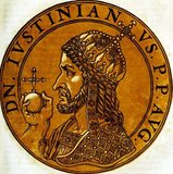 Justinian I (482-565), also known as Justinian the Great or Saint Justinian the Great, was the nephew of Emperor Justin I, originally born from a peasant family in Tauresium. Justin, before he became emperor, adopted Justinian and raised him in Constantinople. Justinian served in the Imperial Guard, the Excubitors, just as his uncle had, and was made associate emperor in 527 before becoming sole emperor when Justin died in the same year.<br/><br/>  Justinian was ambitious and clever, and sought to revive the empire's greatness, planning the reconquest of the western half of the Roman Empire in what was known as 'renovatio imperii' (restoration of the Empire). Justinian was hard-working and known as 'the emperor who never sleeps'. He nearly lost his throne during the Nika riots, and nearly lost his life during the Justinian Plague of the early 540s.<br/><br/>  Justinian was a devout Christian and theologian, and his partial recovery of lost Roman territories led him to be called by some as one of the 'last Romans'. His uniform rewriting of Roman law, the 'Corpus Juris Civilis' is perhaps his greatest legacy, which is still used as the basis of civil law in many modern nations. His restoration activities included the building of the Hagia Sophia. He died in 565 without an heir, succeeded by his nephew Justin II.
