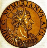 Numerian (-284) was the son of Emperor Carus and older brother to Carinus, who he would be joint emperor with in later life. Carus immediately elevated both Carinus and Numerian to Caesars after his ascension to the throne, taking Numerian east with him to wage war against the Sassanid Empire while Carinus was left in charge of the West.<br/><br/>  Carus soon died after becoming emperor, making Numerian and Carinus the new emperors. While Carinus rushed back to Rome, Numerian lingered in the East, returning at a leisurely and ordered pace, unworried by the Persians due to their own internal issues. However, disaster struck on the way back.<br/><br/>   While travelling through Asia Minor, Numerian began suffering from an inflammation of the eyes and had to travel by closed coach. Somewhere near Bithynia, Numerian's soldiers began smelling an odd odour coming from the coach, like that of a decaying corpse. They opened the coach's curtains to find Numerian dead within.