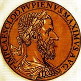 Pupienus (165/170-238), also known as Pupienus Maximus, was a senator in the Roman Senate who had risen to power and influence through military success under the rule of the Severan dynasty. He served two terms as Consul, and became an important member of the Senate.<br/><br/>  When Gordian I and his son were proclaimed Emperors in 238, the Senate immediately recognised them in defiance of Emperor Maximinus Thrax. Pupienus, an elderly man by then, was put on a committee to coordinate efforts to thwart Maximinus until the Gordians could arrive in Rome. The Gordians died less than a month after their declaration however, and the Senate became divided in how to act, ultimately voting for Pupienus and Balbinus, another elderly senator, to be installed as co-emperors.<br/><br/>  Some senators, and the people of Rome, had wanted Gordian III, grandson of Gordian I, to be declared emperor however, and civil unrest gripped the capital. It was not helped that Pupienus and Balbinus argued and quarrelled often, Balbinus constantly worrying that Pupienus was planning to supplant him. Only a few months into their rule, they were dragged naked through the streets by the Praetorian Guard, publicly humiliated, tortured and then executed.<br/><br/>