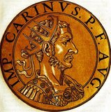Carinus (-285) was Emperor Carus' eldest son, and was appointed Caesar in the beginning of 283, made co-emperor of the western portion of the Roman Empire while his father and younger brother Numerian headest eastwards to fight the Sassanid Empire.<br/><br/>  When his father died in mid-283, Carinus and Numerian became co-emperors of the Empire, with Carinus swiftly returning to Rome to celebrate his ascension. In 284, Numerian was found dead in his closed coach under mysterious circumstances, with Diocletian, commander of Numerian's bodyguards, claiming that Numerian had been assassinated. Diocletian was almost immediately proclaimed emperor by his soldiers, and Carinus was forced to march and face him.<br/><br/>  The two armies clashed in 285, with differing accounts on what occurred. One acount claims that Carinus' forces were winning, but the emperor was assassinated by a jealous tribune whose wife Carinus had seduced. A more believable account claims that Diocletian's troops secured a complete victory, and Carinus' army deserted him, leading to either his death by murder or execution. Carinus posthumously gained a reputation as one of the Empire's worst emperors, a slandering possibly supported by newly crowned Diocletian himself.