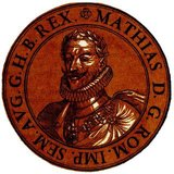 Matthias (1557-1619) was the son of Emperor Maximilian II and younger brother of Emperor Rudolf II. He married his cousin, Archduchess Anna of Austria, becoming successor to his uncle, Archduke Ferdinand II. He was invited to the Netherlands by the rebellious provinces and offered the position of Governor-General in 1578, which he accepted despite the protestations of his uncle, King Philip II of Spain.<br/><br/>   Matthias helped to set down the rules for religious peace and freedom of religion, and only returned home in 1581 after the Netherlands deposed Philip II to become fully independent. He became governor of Austria in 1593 by his brother Rudolf's appointment. He forced his brother to allow him to negotiate with the Hungarian revolts of 1605, resulting in the Peace of Vienna in 1606. He then forced his brother to yield to him the crowns of Hungary, Austria and Moravia in 1608, and then making him cede the Bohemian throne in 1611. By then Matthias had imprisoned his brother, where he remained till his death in 1612.<br/><br/>  After Rudolf's death, Matthias ascended to Holy Roman emperor, and had to juggle between appeasing both the Catholic and Protestant states within the Holy Roman Empire, hoping to reach a compromise and strengthen the empire. The Bohemian Protestant revolt of 1618 provoked his strongly Catholic brother Maximilian III to imprison Matthias' advisors and take control of the empire, Matthias being too old and ailing to stop him. Matthias died a year later in 1619.